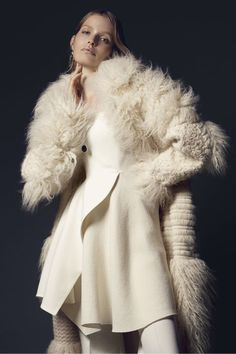 Stella McCartney coat, $5,695, and top, $975, 212-255-1556; Stella McCartney pants, $1,300, Bergdorf Goodman, 888-774-2424;  J.W. Anderson earring, $365, j-w-anderson.com; Tom Wood necklace, $320, and ring, $480, tomwoodproject.com. BEAUTY BAZAAR Plump your skin with Olay Active Botanicals Moisturizing Day Lotion ($14.99).