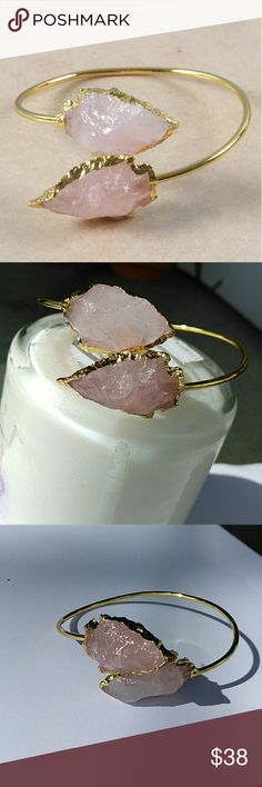 Rose quartz Arrowhead bangle Elegant rose quartz arrowheads in a gold setting This is brand new   Hand knapped  Made in India Fair trade    Inner dia. 32x20x10 mm (millimeter) Jewelry Bracelets