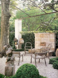"""""""Outside with old faux bois, french fountain and gravel (probably imported from France?)"""" Cote De Texas"""