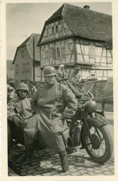 """A Luftwaffe motorcycle team poses by their vehicle. Note the """"WL"""" (""""Wehrmacht Luftwaffe"""") registration plate."""
