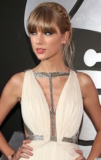 Cute grecian inspired hair style with full fringe and braids worn by Taylor Swift looking fabulous in a couture dress