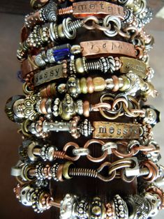 beaded metal bangles with message tags.