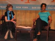 Dr. Terri Kennedy moderating a discussion with yoga master Tao Porchon-Lynch at the Yoga Journal Conference in New York.