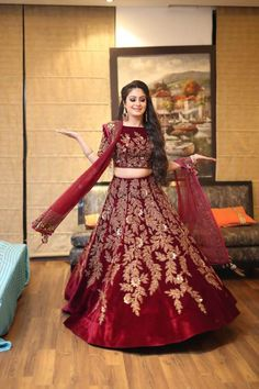 Buy maroon velvet with precipitant lace work & embroidery work designer lehenga choli online.This set is features a maroon blouse in velvet fully embellished with resahm, embroidery.It has matching maroon lehenga in velvet with beautiful embroidery al Wedding Lehnga, Pakistani Wedding Outfits, Indian Bridal Outfits, Pakistani Wedding Dresses, Pakistani Dress Design, Indian Wedding Gowns, Wedding Bride, Wedding Reception, Bridal Lehenga Collection
