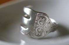 Made from antique silver plated flatware. This pattern/series is called Alhambra.    Upon purchase, please let me know your ring size so that I can custom size your piece of jewelry.