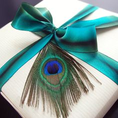 Natural textured wrapping paper, Silk ribbon and a Peacock feather | Simple yet Elegant