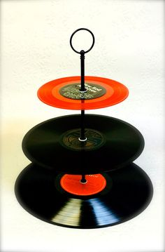 3 Tiered Cup Cake stand Hand made using Vinyl Records  Rock n Roll nights, 21st Birthday, Rockabilly Wedding, Anniversary, DISCO nights  Whatever the occasion it would look amazing  Easy to care for - just wipe clean  Do not place food straight on - use cupcake cases / serviettes etc  The stand will be delivered flat in a box & is easily reassembled - instruction included