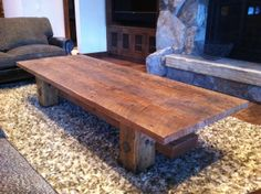 Reclaimed doug fir coffee table. Circular sawn top 3' x 8' Hewn legs with forged iron accents.