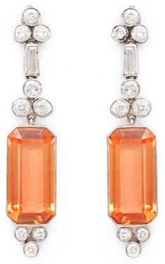 Art Deco Topaz and Diamond Earrings – Pair of precious topaz pendant earrings with round and baguette diamonds, set in platinum. American, ca. 1930 (A La Vieille Russie)