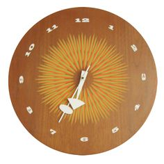 George Nelson clock with graphic face by Howard Miller. United States; 1950's. Wood, enameled metal, electrical clock works. DEPTH: 3 in.;   DIAMETER: 15.5 in.