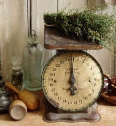 Antique kitchen scales are both practical and look really cool in the kitchen setting.