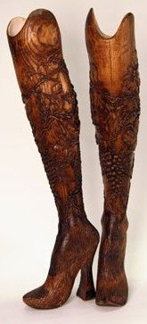 Hand-Carved Prosthetic Legs: Designed by Alexander McQueen. Made of Elm wood, decorated with delicately carved flowers, & originally worn on the runway by double-amputee model & athlete Aimee Mullins.