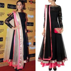 Nargis Fakhri goes for a sweeping style by JADE by Monica & Karishma. The black floral lace embroidered anarkali looks gorgeous on her.