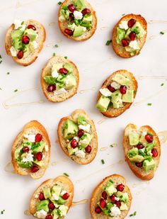 Avocado and Pomegranate Crostini - Avocado, pomegranate and feta make a pretty holiday appetizer crostini.