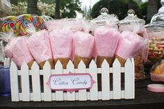 How much fun is this adorable cotton candy display. I love the white picket fence container and that the cotton candy looks like ice cream cones. Awesome.