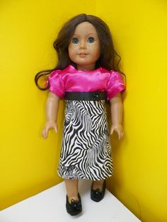 @Candice Stump I made this dress for Katherine's doll with the free pattern at this link http://mycupoverflows-johnson.blogspot.com/2012/03/american-girl-dress-pattern.html