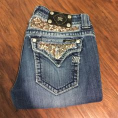 Miss Me Boot Cut Jeans Perfect Condition, Size 29, Inseam 33, Boot Cut Jeans. No rips, holes, or stains. Medium wash with gold sequins on the back pockets. Worn only a few times and I'm selling them because they no longer fit. Miss Me Jeans Boot Cut