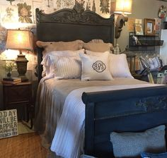 Vintage bed finished in Graphite Chalk Paint® with washes of Coco and Old Ochre. Project by Annie Sloan Stockist The Back Porch Mercantile.