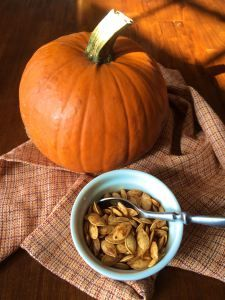 a sugar pumpkin and spicy-sweet pumpkin seeds ~ #farmersmarket #foodwaste #toasted pumpkin seeds #food #nutrition #health #healthyeating #recipe #pumpkin #autumn #Halloween #cooking #vegetarian #vegan #pkway