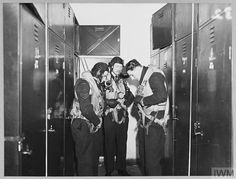 Original wartime caption: For story see CH.8748 Picture made during preparations for an actual raid shows the crew changing into flying kit. Lancaster Bomber, Maximum Effort, Caption, Ww2, Exit Room, Captions