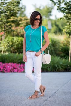 Fashion Over 40: This teal ladder lace linen top from LOFT is stunning paired with white jeans. The Rebecca Minkoff studded gladiator sandals are the perfectly chic finishing touch for this casual summer outfit!
