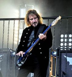 Geezer Butler- Black Sabbath. More than 40 yrs of hard driving bass playing.