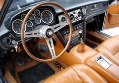 1965 Maserati Quattroporte...you'd need a scarf to drive in this car