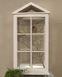 DIY this Unique Window-Frame Birdcage Build your feathered friend a beautiful birdcage using salvaged windows. Watch the Video: See crafter Kristin St. Clair build this project. How to Make a Window-Frame Birdcage Diy Bird Cage, Bird Cages, Parrot Cages, Do It Yourself Upcycling, Parakeet Cage, Recycled Windows, Bird House Kits, Bird Aviary, Wooden Bird