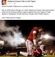 Jalen Hurts praying before the LSU game.