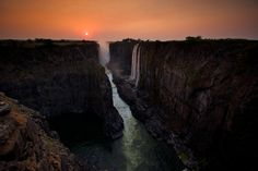 Victoria Falls at sunset Zimbabwe, South Africa ~ Photo by...Charlie Hamilton James.