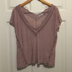Off the Shoulders Top This top by Kimchi Blue (urban outfitters) features rough edges, an off the shoulder look, and a deep V neck line. It is a dusty pink color. Urban Outfitters Tops Tees - Short Sleeve