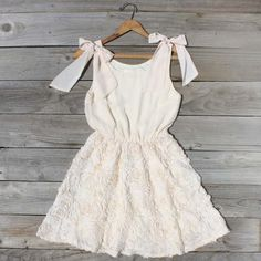 Bicycle Path Dress  $64.00  Billowing rosettes flow from this sweet chiffon dress. Creamy soft chiffon has been perfectly paired with a full flowing rosette skirt and bow tie shoulder details. Beautifully tailored with a stretch gathered waist, darted bust, and fully lined body.