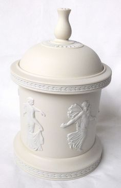 A magnificent limited edition Wedgwood cream jasperware Dancing Hours bijoux box.