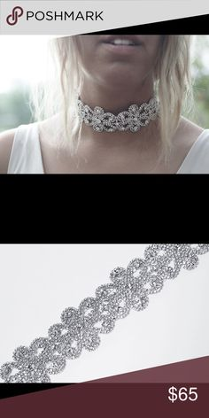 """1 HOUR SALEThe Lera choker rhinestone The Lera is for the girl who wants to make a statement. Her glistening band of rhinestones forms into the shape of flowers. She is dazzling. She is breath taking. She is impressively bold. Secured by a lobster clasp.   Crystal and Silver Rhinestone Zinc Alloy 10 1/2"""" at shortest setting  14"""" at longest setting Imported Asteria the Label Jewelry Necklaces"""