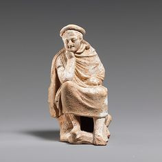 Terracotta statuette of a youth seated on a rock,hellenistic period,ca 300 BC  Greek