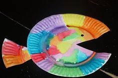 Rainbow fish out of tissue paper on paper plate