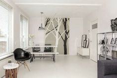 My home in Rotterdam #white floors #trees #hk living lamp #eames repro #chairs loods5 #chair Ikea # Ikea ps locker #interior on a budget #clean