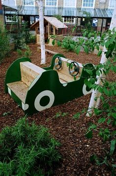 School play area with play car, western red cedar play house and balance beam with play bark surfacing