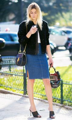 Black bomber jacket, denim pencil skirt, black mule heels, and a Chloe bag