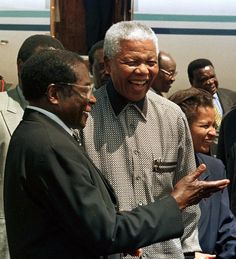 These two men have shaped their countries in dramatically different ways.  Zimbabwe's President Robert Mugabe, left, greets South African President Nelson Mandela in Harare, Zimbabwe, in 1998.