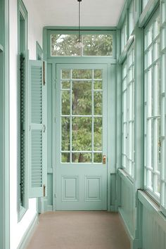 Pretty mint painted sunroom.