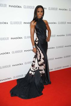Kelly Rowland's back! For now, and in a stunning full length gown by Maria Grachvogel