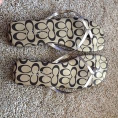 Coach sandals Coach leatherware c pattern flip flops. Signs of wear on inside straps and bottom are shown in pic Coach Shoes Sandals