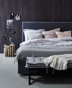 Not to keen on the dark wall colour, but bedding is pretty ): Maybe with a light grey wall instead....