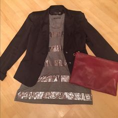 Grey sequence t-shirt Grey sequin t-shirt. Long in length. Can be worn casually out or could be dressed up for night on the town! Worn only a few times. All sequins are in tact. Apt. 9 Tops Tees - Short Sleeve