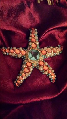Check out this item in my Etsy shop https://www.etsy.com/listing/205470157/vintage-brooch-pin-kjl-starfish-rare