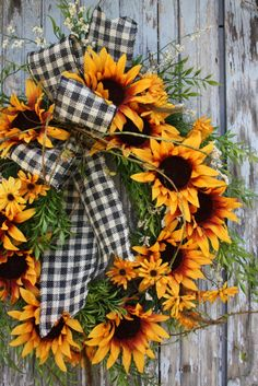 "This wreath is great for late summer, early fall.  Beautiful big sunflowers accented with pretty black and white gingham burlap ribbon.Finished size is 24""."