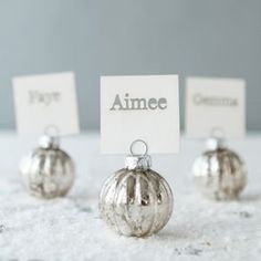 Silver Bauble Place Card Holders Welcome guests to their seats with these classy, crackled glass bauble place card holders and place Christmas Place Cards, Christmas Names, Silver Christmas Decorations, Christmas Table Centerpieces, Christmas Table Settings, Christmas In July, Christmas Place Setting, Christmas Wedding, Wedding Place Names