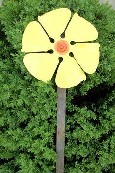 Old metal fan blade flower.
