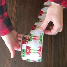 Back by popular demand, here is a tutorial how to tie a Christmas bow with wire ribbon when the pattern is not on both sides. Step 1. Fold your ribbon over itse…